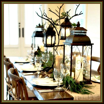 rustic christmas table scape with burlap runner and vintage style lanterns