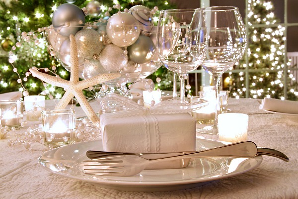 Elegant Coastal Holiday Dinner Table With Wine Glasses and White Ribboned Gift