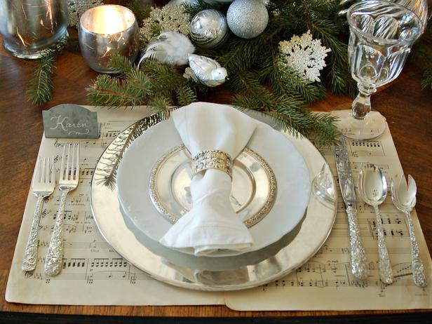 White and Silver Place Setting on a Sheet Music Placemat