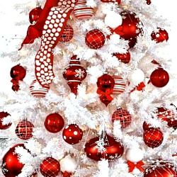 white christmas tree with red ornaments