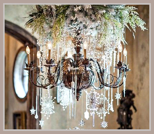 Silver Christmas Chandelier Decorated with Fresh Greens, Hanging Crystals, and Sparkling Snowflakes