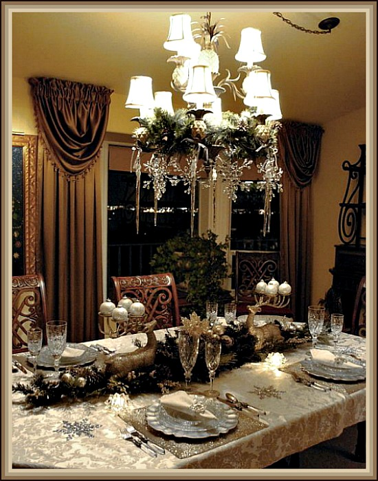 Elegant Silver Christmas Tablescape with Evergreen Center Piece Flanked by Silver Reindeer
